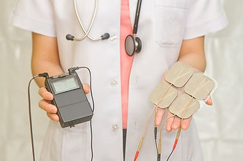TENS-device-and-sticky-pads.jpg