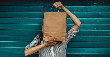 Woman-Holding-A-Shopping-Bag-1200x628-facebook-1-1200x628.jpg