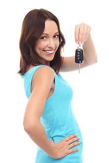 Smiling woman holding car key.jpg