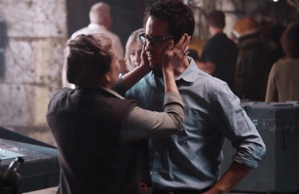Carrie Fisher and J.J. Abrams on the set of The Force Awakens. Abrams has been vocal from his beginnings on Star Wars of his admiration and appreciation for the late actress.
