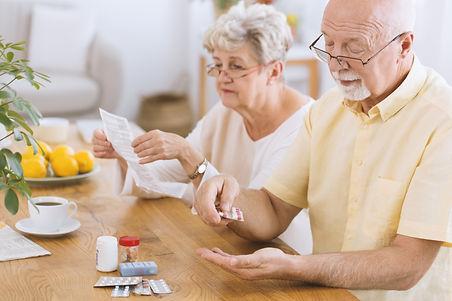 Senior man taking medication for diabete