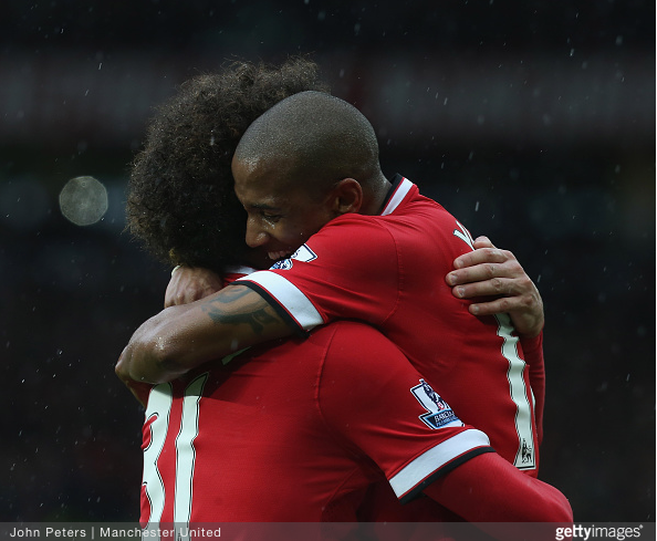 Young and Fellaini celebrate Manchester United's 2nd goal