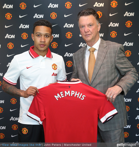 New Signing Dutch Winger Memphis Depay standing with Manchester United Manager Louis van Gaal following the completion of his transfer at the Aon Training Complex on June 12, 2015_Courtesy of John Peters Getty Images.