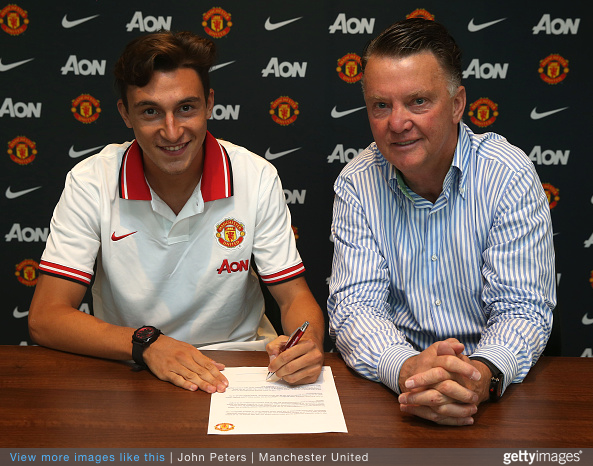 Matteo Darmain completes his move from Torino to Manchester United. Van Gaal sits next to him at Aon Complex.