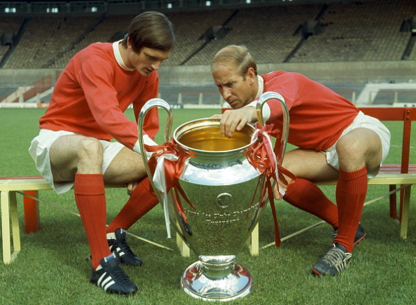 Jimmy Ryan (left) and Bobby Charlton of Manchester United looking at the European Cup at Old Trafford, Manchester, July 1968. (Photo by Popperfoto/Getty Images)