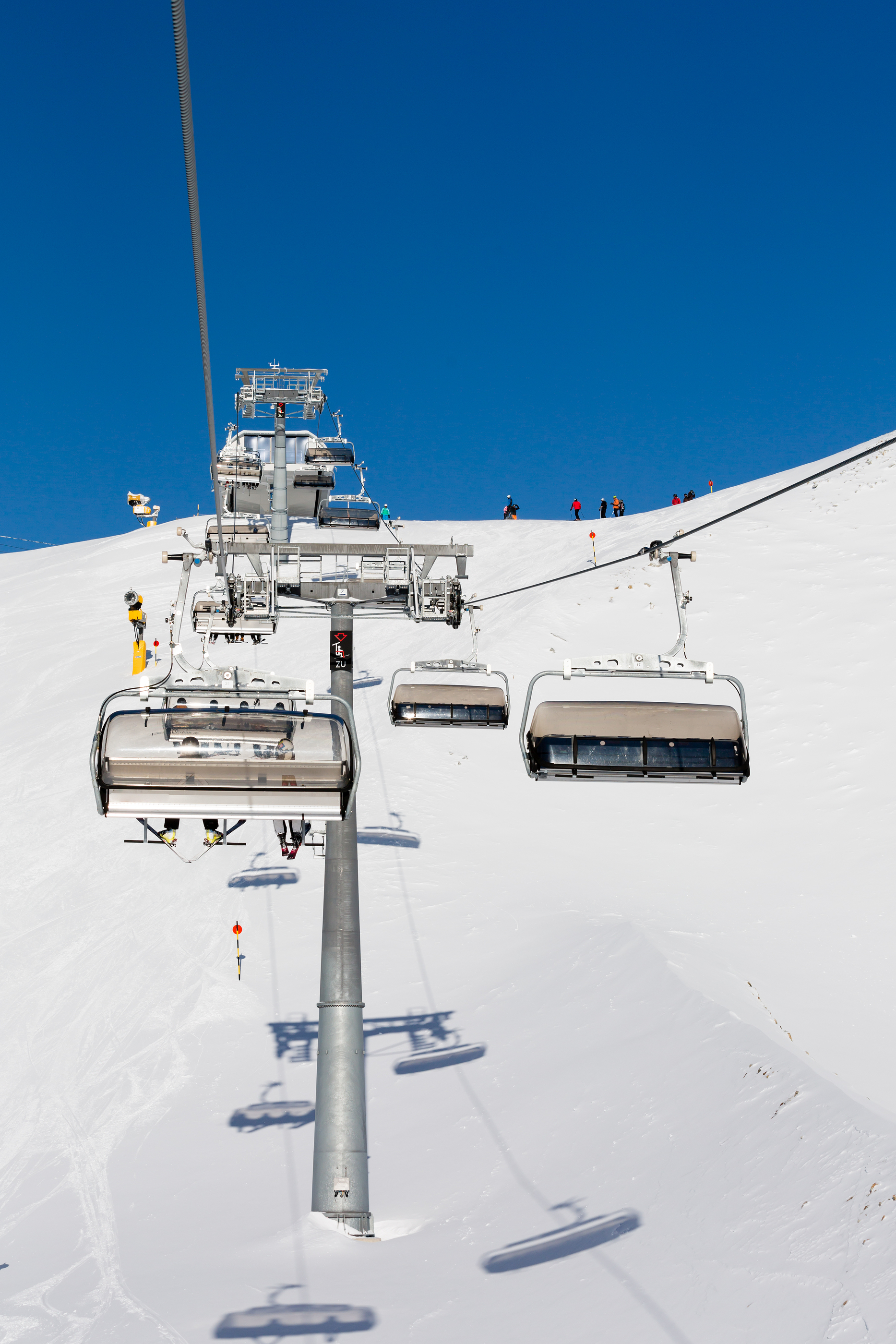 Chair Lift And Skiers