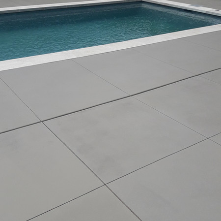 Colour tinted sealer applied to Swimming pool surround
