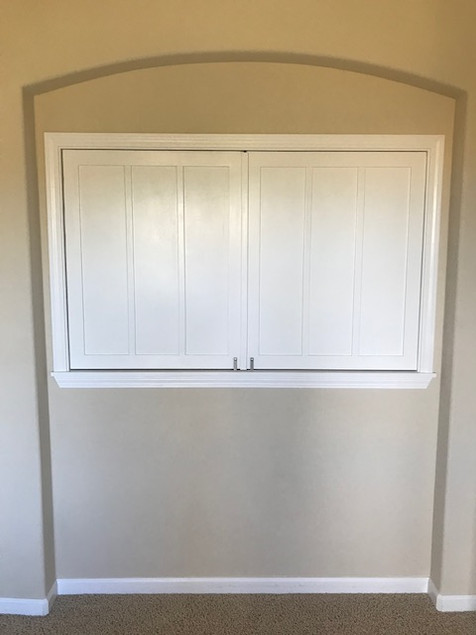 Guest room enclosure wall and custom shutter