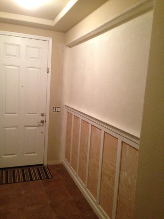 Entryway wall enclosure with wainscot