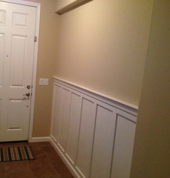 Entryway wall installation with wainscot