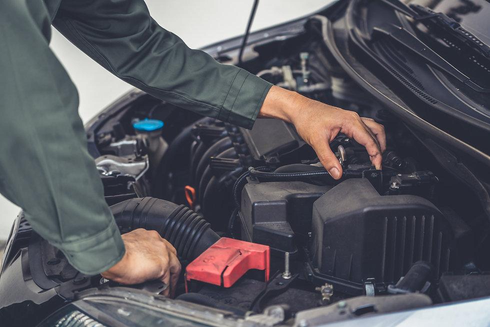 professional-mechanic-hand-providing-car
