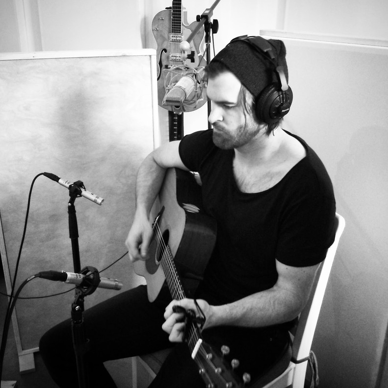 Jon Bryant recording acoustic guitar for 'Love and War'.