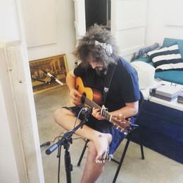 Joshua Smith recording acoustic guitar.