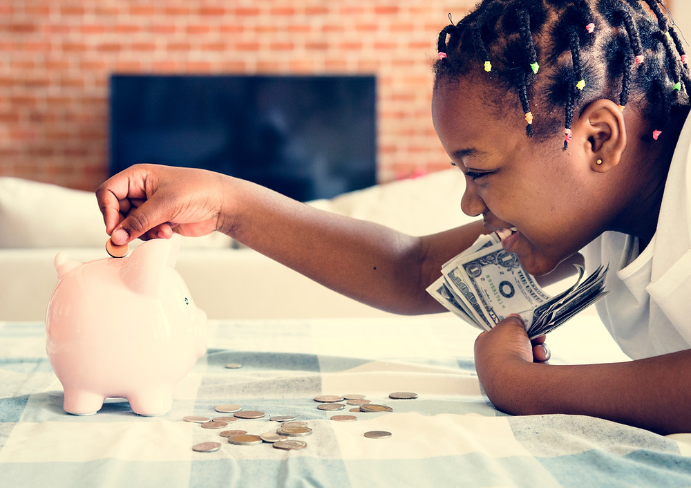 little girl putting money in piggy bank, finance, learning, happy