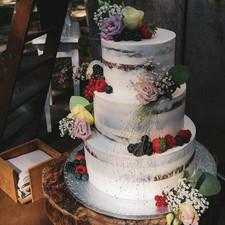 Semi naked wedding cake fruit flowers