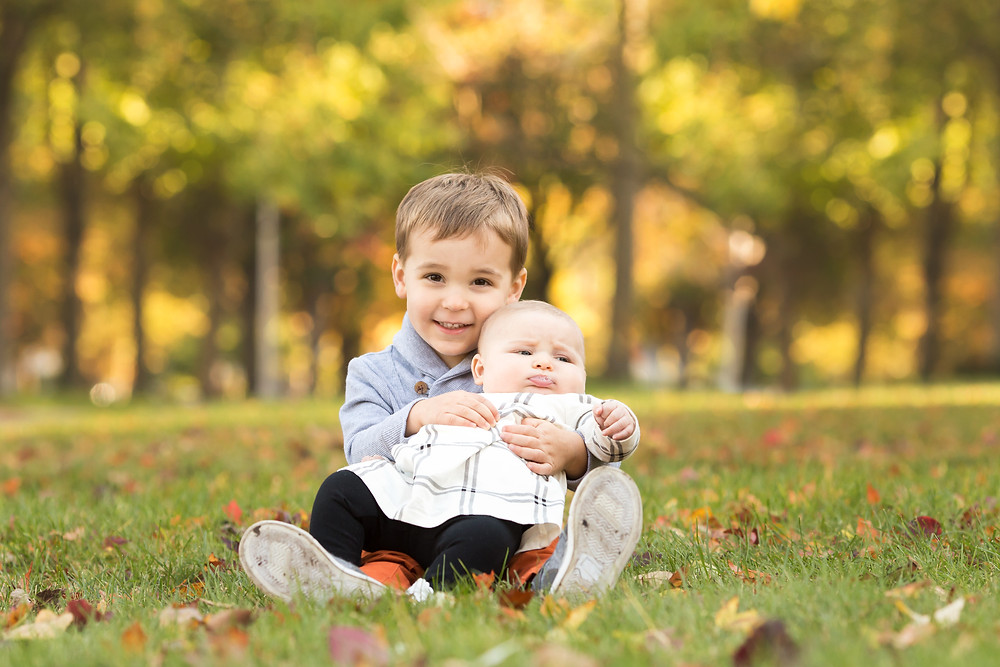 Grosse Pointe Toddler holding his baby sister