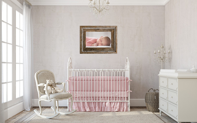 nursery with Asher frame and newborn pho