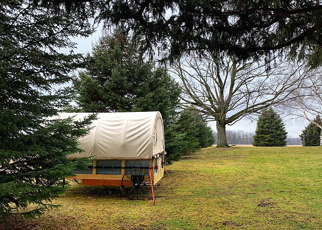 glamping covered wagon, isolated vacation, chuck wagon camping, glamping, river front view, country getaway, discover ontario