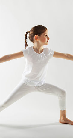 Child doing yoga to help calm a mental disorder to keep a healthier midset.