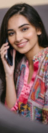 photo-of-smiling-woman-talking-on-phone-