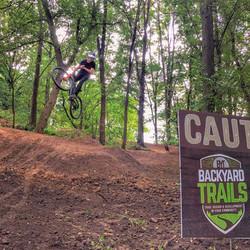 trail work sign jump