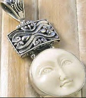 "2"" Carved Bone Goddess Face Sterling Silver Pendant"