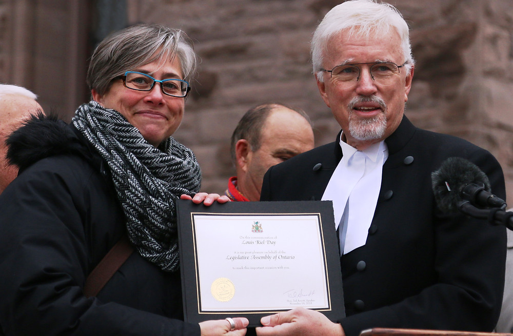 MNO President Margaret Froh receives the Louis Riel Day  from Deputy Speaker of the Legislative of Ontario MPP Rick  Nicholls during the 2018 Louis Riel Day ceremony outside  Queen's Park on Nov. 16.