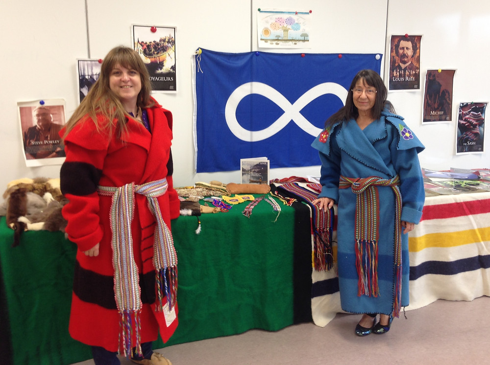 MNO Grand River Métis Council President Jennifer Parkinson (left) and MNO citizen Barb Lair (right) hold a workshop to educate students and teachers on Métis culture and heritage.