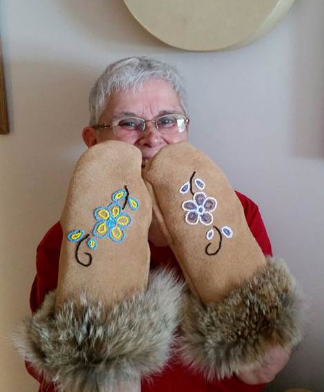 MNO Grand River Métis Councilor Diane Kilby  proudly displays the moose mitts she created at the Moose Mitt Workshop.