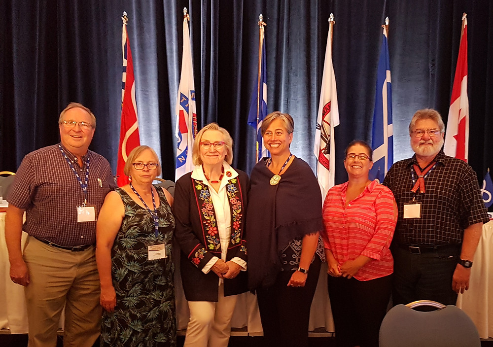 Presidents from the Métis National Council governing  members signed a Housing Sub-Accord with the federal  government on July 19 at the General Assembly of the  Métis National Council. On hand for the signing were a  number of MNO representatives. Pictured are PCMNO  Secretary-Treasurer Tim Pile, MNO Chair France Picotte,  Minister of Crown-Indigenous Relations Dr. Carolyn  Bennett, MNO President Margaret Froh, PCMNO Region  1 Councilor Theresa Stenlund and PCMNO Region 4  Councilor Ernest Gatien.