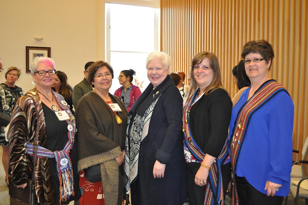 MNO GRMC members with Lieutenant Governor Dowdeswell  and First Nation Elder MacDonald (left-right): Senator Carol Lévis, Elder Lois MacDonald, the Honourable Elizabeth  Dowdeswell, President Jennifer Parkinson and Treasurer Leslie Muma.
