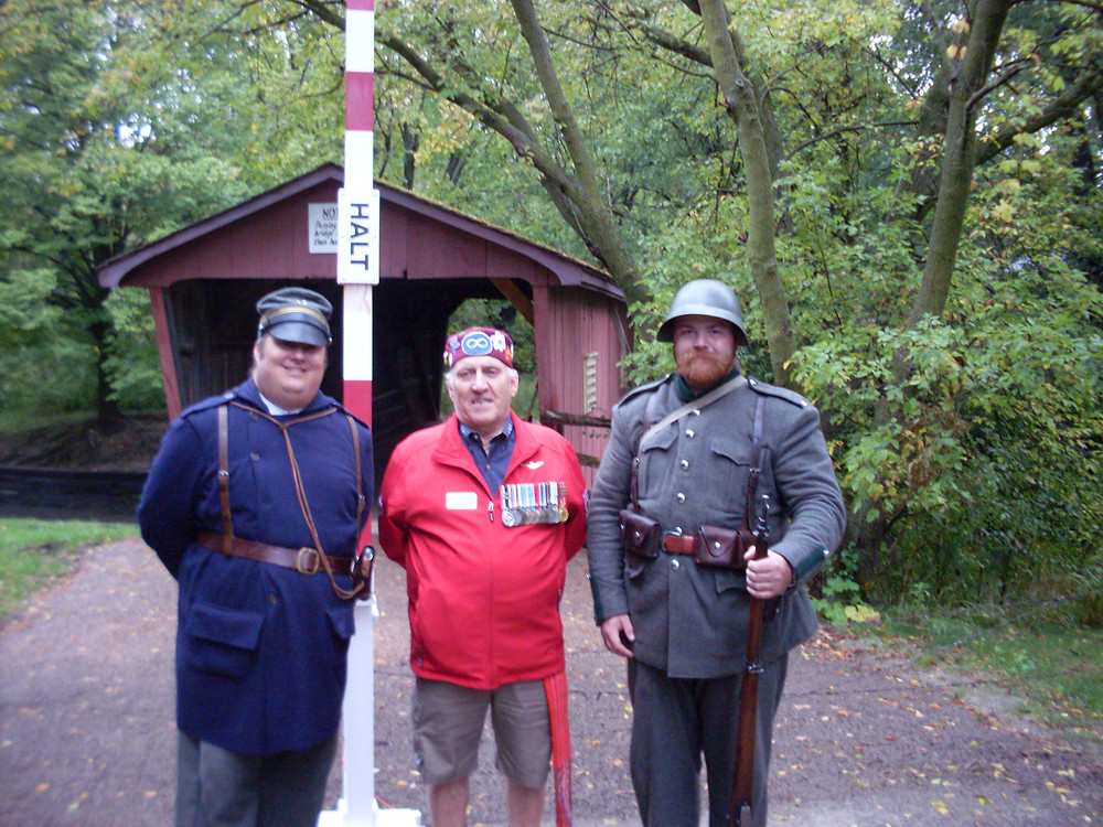 MNO Veterans' Council Senator Guy Mandeville, CD,  standing between two Great War re-enactors, participated  in Waterloo Region Museum's Great War Education Days  on Oct. 1-2.