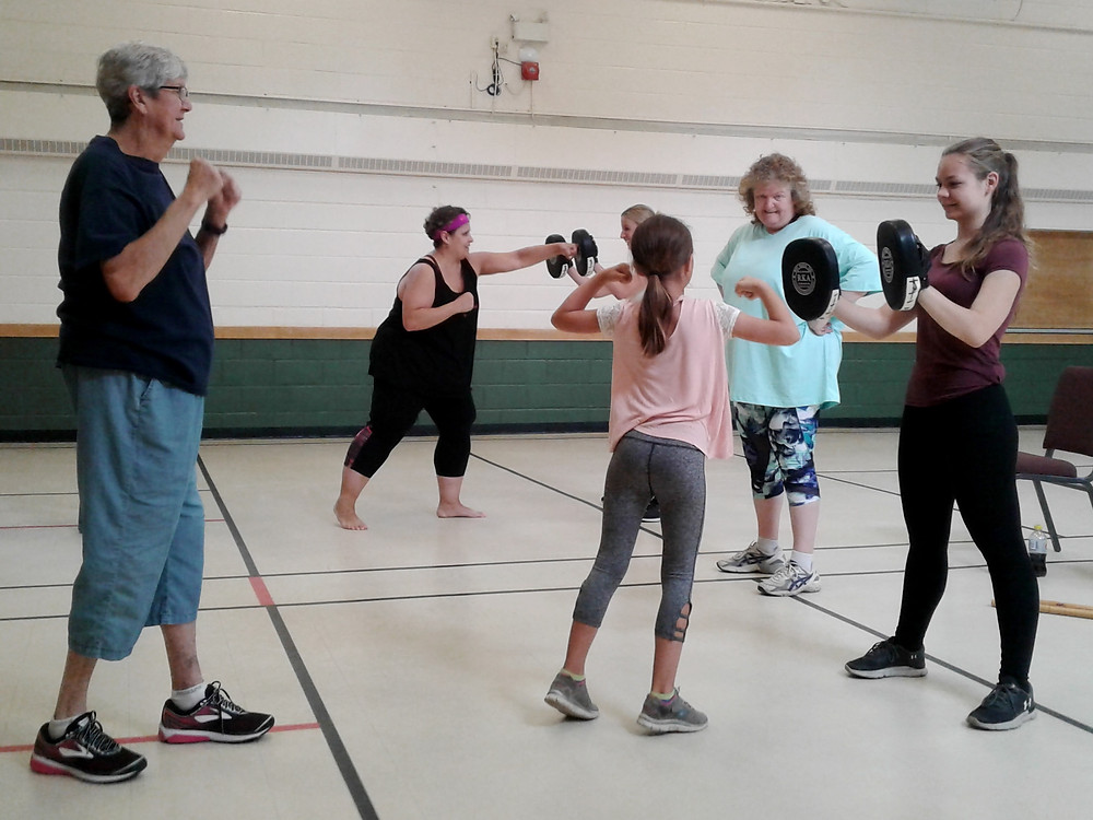 Participants in the Women's Self-Defence and Personal  Safety workshop learn how to protect themselves during a  physical confrontation. The workshop was hosted by MNO  Grand River Métis Council and taught by RCMP Métis  Liaison Cpl. Cheryle Hayden.