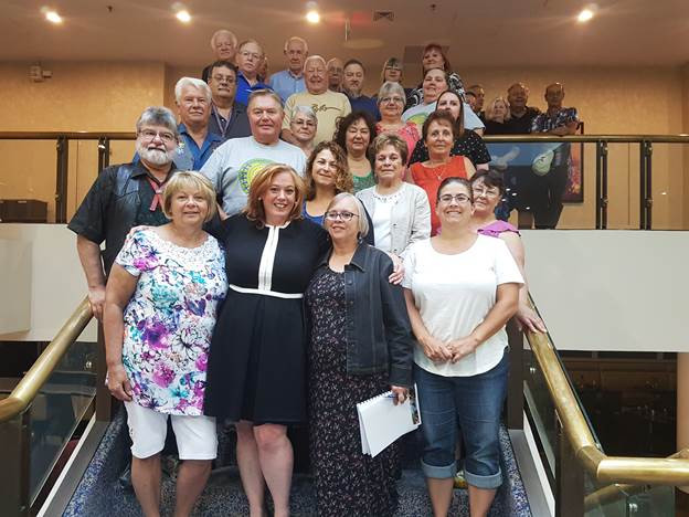 Representatives from the PCMNO, Community Councils  and other MNO citizens participated in the federal  government's Indigenous languages consultation in  Toronto on July 12. This picture features the MNO group  with Lisa MacLeod, Minister of Children, Community and  Social Services and Minister Responsible for Women's  Issues, who was attending another meeting at the same  location.