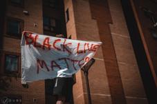 Protester atop a bus stop