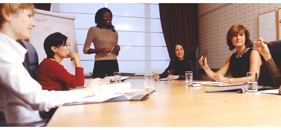 women in board room color.png