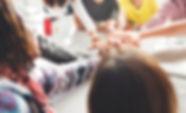 women circle hands.jpg