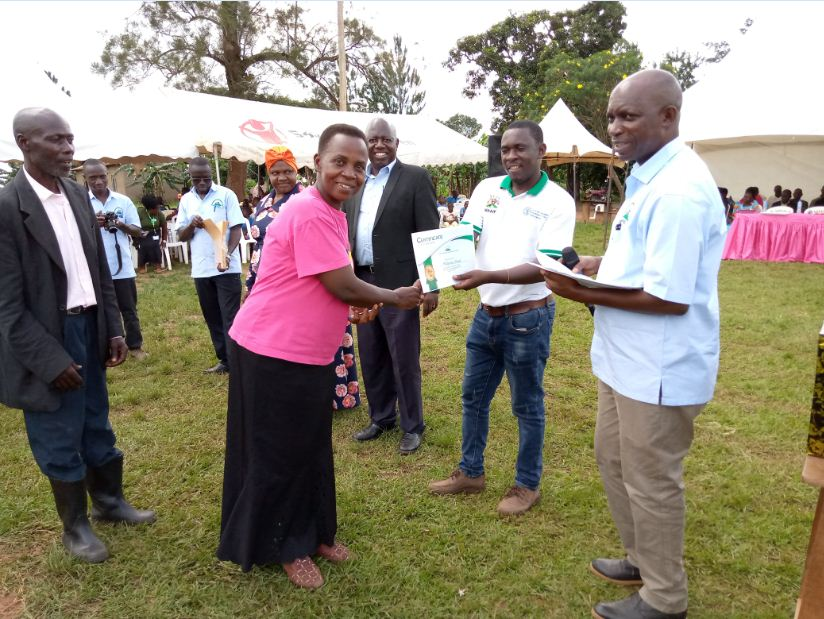 A farmer Trainer receives a certificate