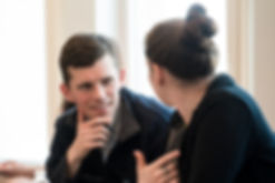 Two Mongan Institute colleagues talking to each other during a meeting