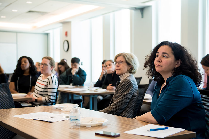 Mongan Institute faculty listen during a meeting