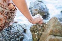 cross holding on rocks