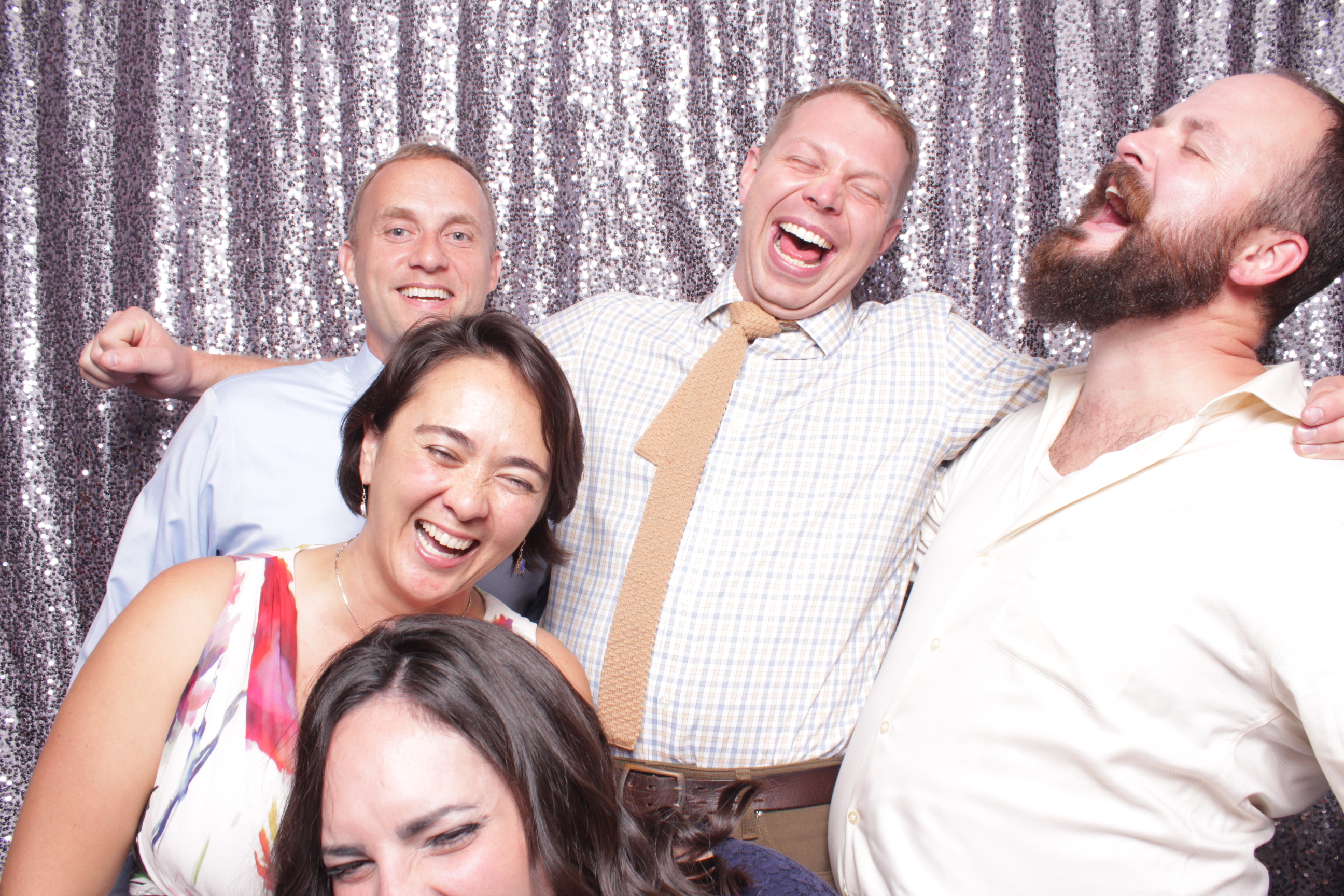 Group of guests using photo booth