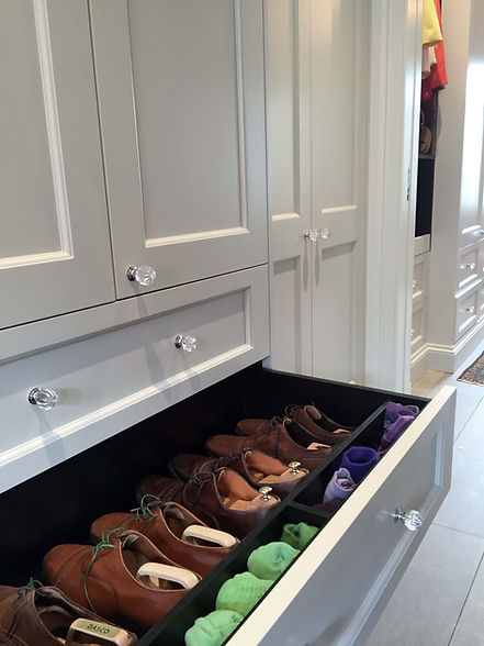 Fitted wardrobe drawer to keep shoes and socks tidy at the property in Chelsea.