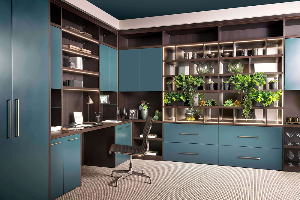 A Neatsmith integrated wall unit provides a home office space