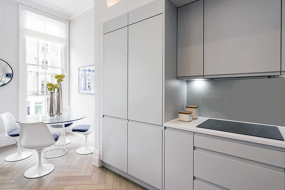 Open plan kitchen in luxury renovation at Cathcart Road by London interior designer Catherine Wilman.