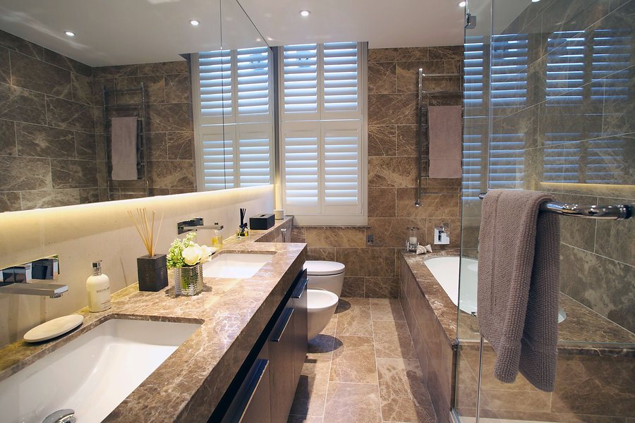 The marble bathroom in the interior design ensuite is a stunning addition to the contemporary apartment.