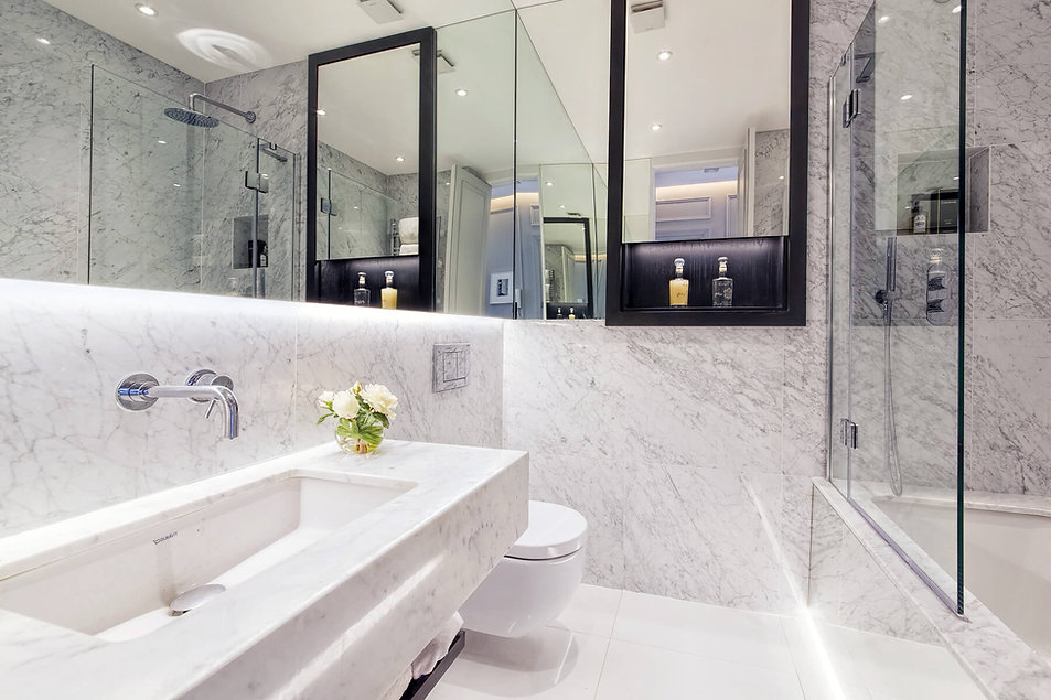 White marble bathroom for a luxury renovation at Cathcart Road by London interior designer Catherine Wilman.