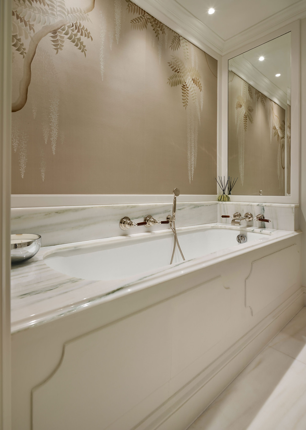 Luxury interiors: Cast iron bath with a figured marble surround
