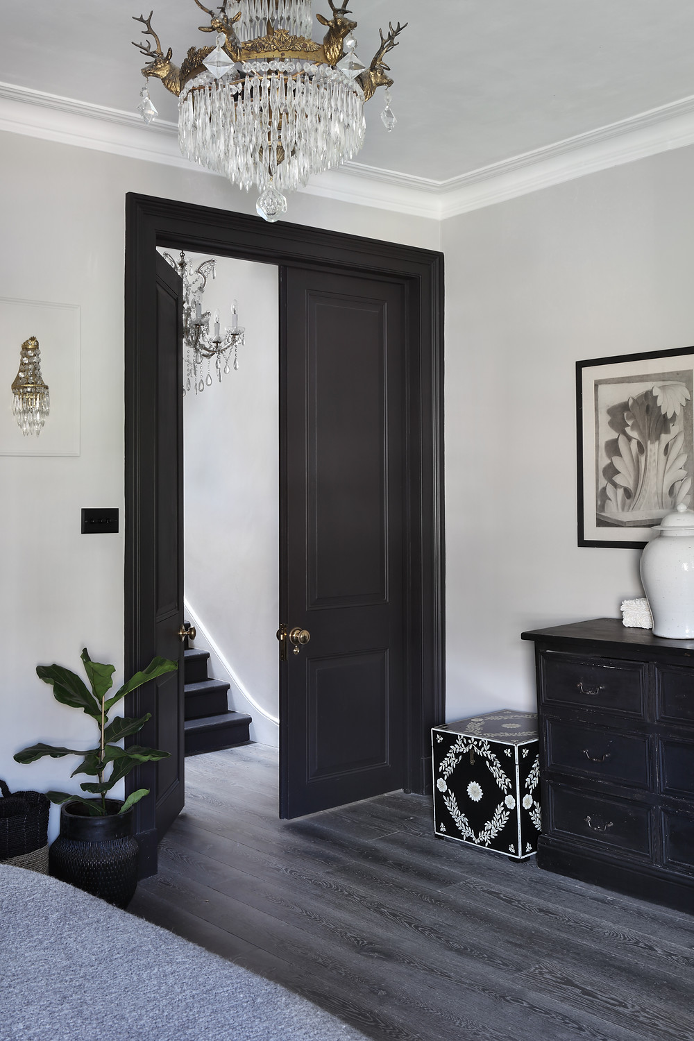 A set of tall double doors has a dramatic impact in this bedroom in Shepherds Bush