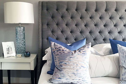 Bedroom show home setting by Catherine Wilman at Bolingbroke Park, London.